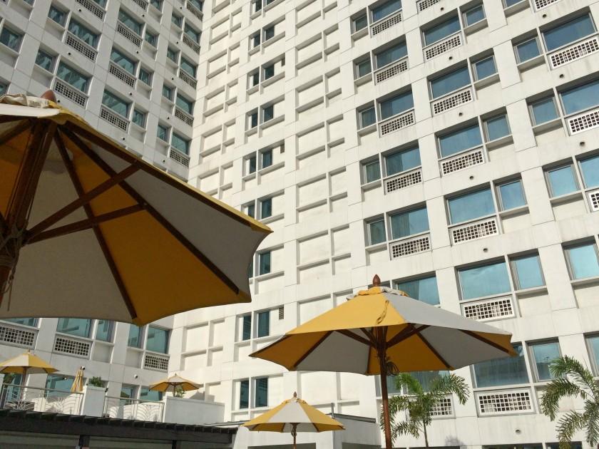Pool umbrellas Quest Hotel